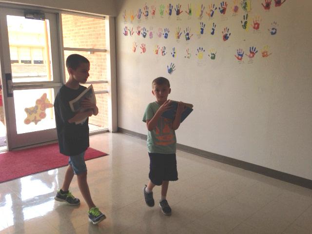 Oak Creek students bringing in the new books